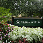 Lush summer flowers adorn this welcoming William & Mary sign.