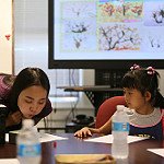 A graduate student demonstrates the first step in creating a Mei Hua, or Chinese plum tree, during the W&M Confucius Institute's recent Chinese Culture Summer Camp.